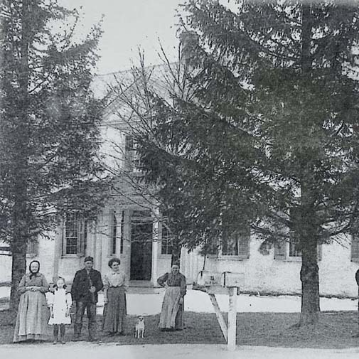 Klessig Family Outside of Saxonia House