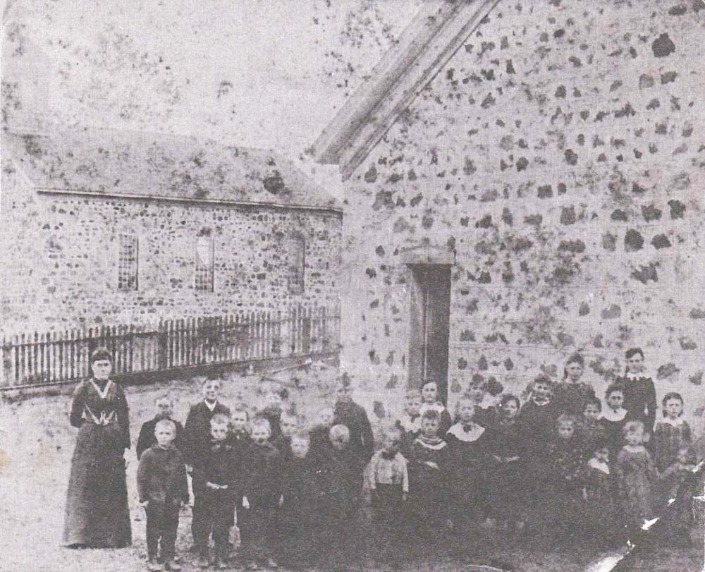 Teacher & Students in Front of St. Peter's School 1881